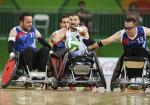 Kory Puderbaugh of United States and Christophe Salegui and Jonathan Hivernat of France compete during the Wheelchair Rugby match between United States and France