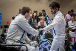 Iraq refugee Wissam Sami greets Canada's Ryan Roussel during the IWAS Wheelchair Fencing World Cup in Warsaw, Poland