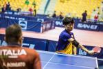 Male Korean table tennis playe in wheelchair hits a backhand shot