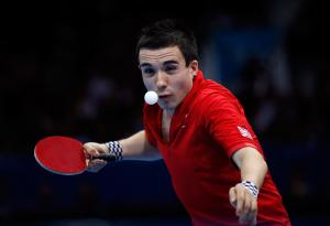 A picture of a man playing table tennis
