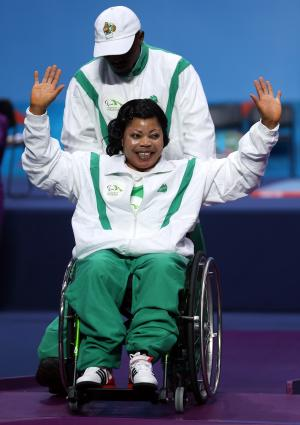 A picture of a woman in a wheelchair celebrating her victory