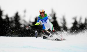 A picture of a woman skiing on the slopes