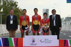 Three Chinese athletes standing on the podium