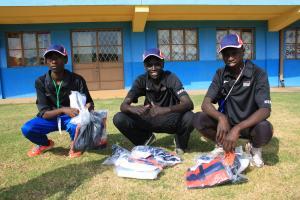 Three Kenyans opening welcome packs