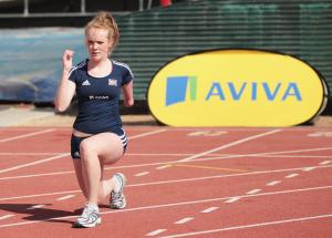 A picture of a girl who is training on an athletic field