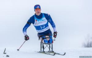 Man in sit ski doing cross country skiing