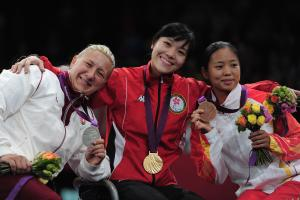 A picture of three women showing their medals