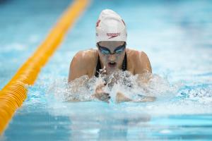 Woman in the pool swimming breaststroke