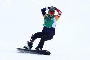Athlete celebrating in snowboard