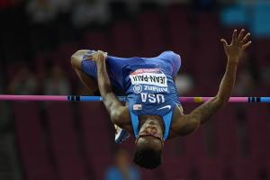 A man mid-leap in the high jump clearing the bar