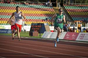 male vision impaired sprinter Jason Smyth runs towards the finish line