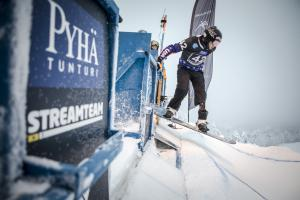 a Para snowboarder rides out of the start gate