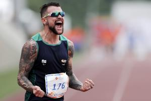 Brazilian sprinter Vinicius Rodrigues screams in joy after a race