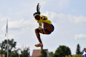 Ecuadorian athlete Kiara Rodriguez flies in the air after jumping